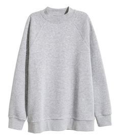 Gray melange. Oversized sweatshirt with long raglan sleeves and ribbing at neckline, cuffs, and hem. Soft, brushed inside.