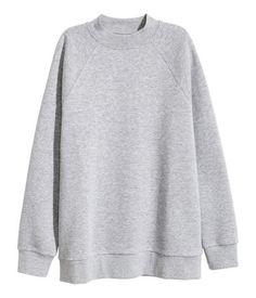 Gray melange. Oversized sweatshirt with long raglan sleeves and ribbing at neckline, cuffs, and hem. Soft, brushed inside.