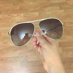 """Authentic Gucci GG 1827/S aviator sunglasses These sunnies/aviator style are oldddd! They do have minor scratches """"everywhere"""" but you can't see any when you put them on. I had the case but I usually keep them in the car, and the heat/sun destroys them, so I had to throw it out! Violet lenses, gold frame & white bar. I can only include a ray ban case for future protection. If you like more pictures feel free to contact me. Gucci Accessories Sunglasses"""