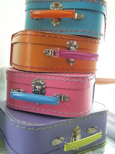 Colorful small suitcase for display or holding kiddos collections.