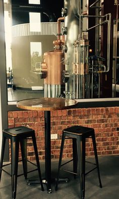 """Our glass front production area, where you can sit and have a sip while watching our yummy bourbon and rye whiskey flow through our exclusive """"Double Barrel"""" spirit safe."""