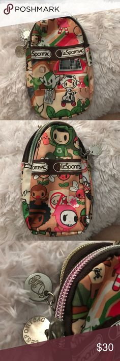 Tokidoki Lesportsac change 2 phone bag cigarette Tokidoki Kawai style 2 pocket bag by Lesportsac.  Features authentic try tricolored metal zippers with zipper pulls of the word Lesportsac one side and the cute little Tokidoki figure other side see photos. On top is a hook for a keychain keychain is not included. Bag is in excellent shape practically like new no with no stains, tears, clean see photo. LeSportsac Bags Mini Bags