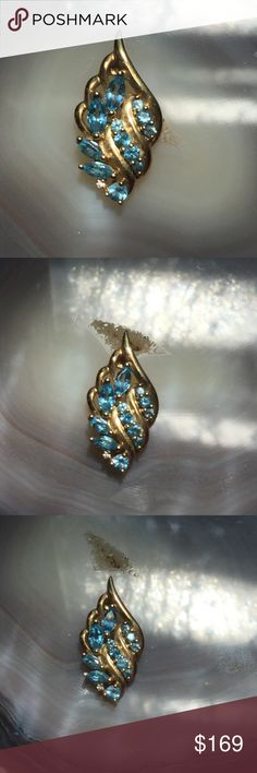 """10k YG  Gorgeous Sky Blue Topaz Winged Love  This lovely Pendant with Marquis & Round Sky Blue Topaz is Fabulous. Soft / Dreamy Blue Topaz cascade down and feather across this lovely piece.  It is 1 1/4"""" long, at its fullest 1/2"""" wide.  You will fall in love with the color and the clarity of these Topaz Gemstones. Sold without chain. Topaz Dreams  Jewelry Necklaces"""