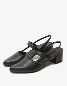 Slingbacks from Intentionally Blank in Black. Smooth leather upper. Pointed toe. Straps across arch and around ankle with subtle elasticized inset at medial side. Lightly padded footbed. Covered block heel with rubber cap.    •	Leather upper  •	Synthetic