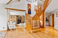 hallway with impressive wooden staircase Wooden Staircases, Hallway Lighting, Hallways, Property For Sale, Bed, Furniture, Home Decor, Wooden Stairs, Foyers