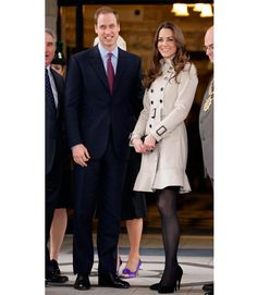Kate Middleton wore a Burberry trench coat with skirt detailing to a fundraiser in Belfast, England.     - HarpersBAZAAR.com