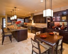 i like the warmth of this kitchen. dark cabinets,tilefloor