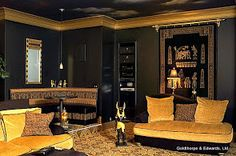 Egyptian themed home theatre with night sky ceiling mural with fiber optics. Goldthorpe & Edwards, Ltd.