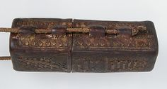 Portable Reliquary Case  Date:     ca. 1400 Culture:     French Medium:     leather (cuir bouilli), boiled and tooled, traces of gilding Dimensions:     Overall: 4 15/16 x 1 5/16 x 13/16 in. (12.6 x 3.3 x 2 cm) leather case only: 3 1/8 x 1 5/16 x 13/16 in. (8 x 3.3 x 2 cm) Classification:     Leatherwork Accession Number:     1984.24.2