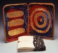 "Precious by Karen Kunc.  1992  bookwork: woodcut, letterpress on washi paper, gold leaf, polished stones, silver  9 x 7 x 2"""