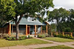 Check out this fixed-up farmhouse with new landscaping and modern potted plants from HGTV's Fixer Upper.