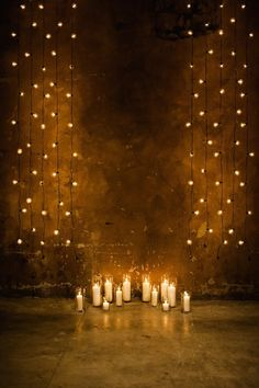 string lights against wall hung vertically