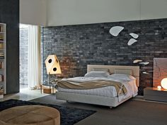 Roohome.com - Do you want to renovate your bedroom with a trendy design? This is the time that you can try to arrange your room. We would like to introduce kind of fashionable bedroom designs which combining with brick and wooden decor ideas around it. You may check and see a variety of ...