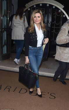All in the jeans:Zoe Hardman stuck with the denim look favoured by many on the day, as she paired her jeans with a white pussybow blouse and a striking fitted jacket