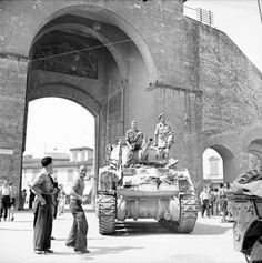 A South African crew of a Sherman artillery Observation Post (OP) tank of the 22nd Field Regiment, South African 6th Armoured Division, enter Florence through the Porta Romano at Piazza della Calza. Florence, Province of Florence, Tuscany, Italy. 4 August 1944.