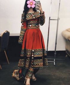 Garnet Afghan Kuchi Dress full of rich embroidery and mirror work ready to makes you stand out in the next events. Pakistani Dresses Casual, Indian Fashion Dresses, Dress Indian Style, Pakistani Dress Design, Indian Designer Outfits, Indian Outfits, Designer Dresses, Pakistani Party Wear, Balochi Dress