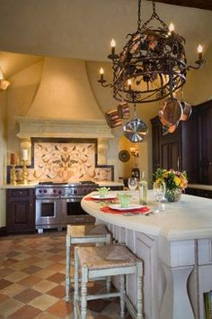 Traditional kitchen with fabulous mosaic backsplash, custom hod, and antique terracotta floor tile.