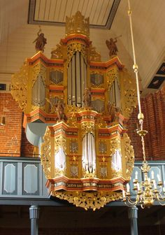 The pipe organ in the Evangelical Lutheran Church in Marienhafe (East Frisia), Lower Saxony, Germany.