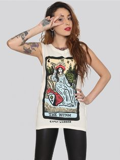 GYPSY WARRIOR Vintage white muscle tank with a witch playing card graphic on the front. Features inside-out seams and distressed detailing throughout. Includes raw edges at the armholes and an oversize fit. By Gypsy Warrior.