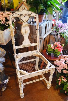 Repurposed chair decorated with found treasures