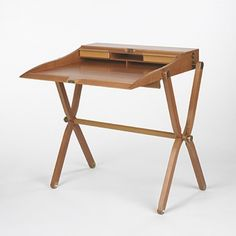 HERMES    folding writer's desk    France, c. 1990  pear wood, natural box leather, brass  32 w x 17 d x 31.5 h inches