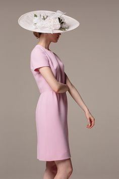 147b8299 A pale pink wool crepe dress, with shirring at the waist for a softly  fitted shape. Shown here with a Rachel Trevor Morgan hat.