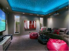Baby!!!! Here's our theater!!! Love sac couch,  bean bags, big screen tv, check out that ceiling!!!! Do you love it?  XerikaX