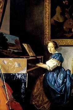 Young girl playing a harpsichord