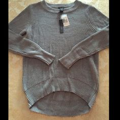NEW gray crochet knit hi-lo sweater medium M New with tags from only mine. Retails for $70. True gray color. Hi-lo hem. Crochet knit style. Size medium, and I'd say this runs a hair on the small side so would work well for someone a size XS or small if looking for a slightly oversized sweater. Sweaters Crew & Scoop Necks