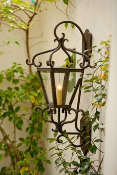 S65 Siena Wall Lantern in Salmon Rust finish with Seeded Glass; Laura Lee Designs