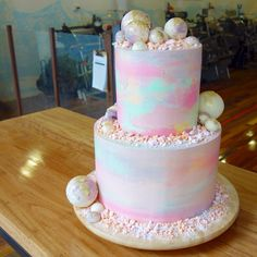 Layers of coconut cake, filled with lemon curd & freeze-dried raspberry buttercream. Frosted in watercoloured vanilla bean Swiss meringue buttercream & adorned with crushed passion fruit meringue & handmade white chocolate spheres Pretty Cakes, Cute Cakes, Beautiful Cakes, Amazing Cakes, Fancy Cakes, Mini Cakes, Cupcake Cakes, Watercolor Cake, Pastel Watercolor