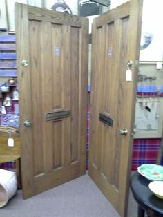 $300 - This is a matched pair of vintage oak doors that have been hinged together. EACH door has the original brass slot. Sold only as a set. They measure  35 1/2 inches by 80 inches.  They are solid oak and very heavy. They can be seen in booth D 1 at Main Street Antique Mall 7260 East Main St ( E of Power Rd ) Mesa 85207  480 9241122 open 7 days 10 till 530 Cash or charge 30 day layaway also available