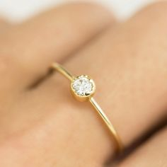 Antique inspired diamond solitaire ring. This ring is perfect to be stacked or worn alone. The milgrain finish on the setting gives antique touch to this sim...