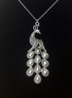 Large silver peacock necklace on Etsy, $17.00