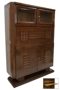 Oak cabinet in three sections, the top section with two glass doors above a fall front section with one interior shelf, the lower section with two doors and two interior shelves by Charles Dudouyt. Bookcase Storage, Sideboard Cabinet, Oak Cabinets, Glass Doors, Bookcases, Shelf, France, Fall, Interior
