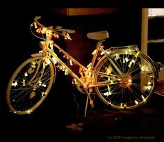 gorgeous bike lit with fairy lights.