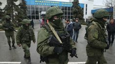 """Political tension grows in Ukraine's Crimea region Armed men patrol outside the Simferopol International Airport in Ukraine's Crimea region on Friday, February 28. The gunmen, whom Ukrainian Interior Minister Arsen Avakov called part of an """"armed invasion"""" by Russian forces, appeared around the airport without identifying themselves. Crimea is an autonomous republic of Ukraine with an ethnic Russian majority."""