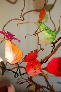 bird fairy lights sitting in branches -- string egg covered with tissue paper and embellished