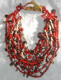 Ecuador | Original coin and bead necklace worn by the Otavalo Indians. | © Linda Pastorino
