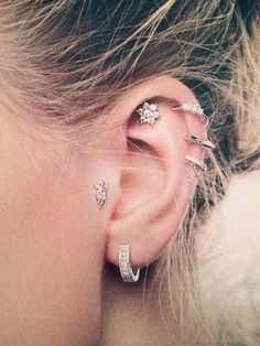 Tragus with Conch and Triple Helix Piercing