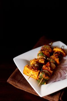 paneer tikka on stove top recipe - spiced marinated cottage cheese cubes pan fried on a tawa or griddle. step by step recipe.