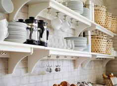 Milk jugs, glasses, plates and coffee cups displayed on STENSTORP white wall shelves
