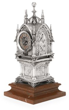A French silver and enamel Gothic style table clock with phases of the moon, modeling attributed to Lucien-Clement Steiner, Tiffany & Co., Paris, dated Unusual Clocks, Cool Clocks, Antique Clocks, Antique Silver, Retro Clock, Gothic Furniture, Mantel Clocks, Grandfather Clock, Large Clock