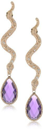 """Rebecca """"Manhattan"""" Rose Gold Over Bronze Snake Amethyst Earrings REBECCA. $375.00. Made in Italy. Rose gold snake earrings with pear shaped amethyst colored stone and crystals. Embellished with 'Rebecca' logo and 'Made in Italy' stamp. Rose gold snake earrings with pear shaped amethyst colored stone and crystals Made in IT. 18k rose gold over bronze"""