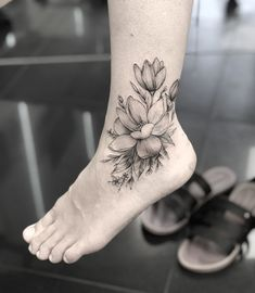 44 beautiful magnolia tattoo designs floral tattoo designs m Ankle Foot Tattoo, Floral Foot Tattoo, Floral Tattoo Design, Flower Tattoo Designs, Flower Tattoos, Ankle Tattoo Cover Up, Ankle Tattoo Designs, Cute Ankle Tattoos, Leg Tattoos