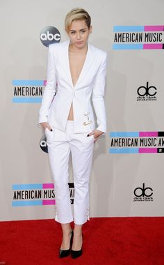 Pin for Later: 26 Times Miley Cyrus Totally Forgot a Piece of Clothing When she suited up, but left her shirt at home. On the red carpet at the 2013 American Music Awards.