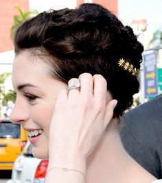 Remember Anne Hathaway's pixie? This simple 'do with rolled-back sections and a gold starry clip proves that, yes, even pixies can be pinned up.