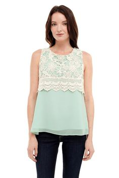 Sleeveless crochet scoop neck top with scalloped detail. This romantic top brings out your girly side!