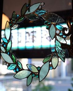 Stained glass wreath perfect for Christmas but could probably be used all year! Stained Glass Ornaments, Stained Glass Christmas, Stained Glass Suncatchers, Stained Glass Crafts, Stained Glass Lamps, Stained Glass Designs, Stained Glass Patterns, Leaded Glass, Stained Glass Windows