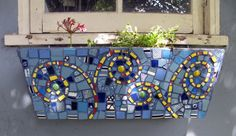 Swirly mosaic planter.